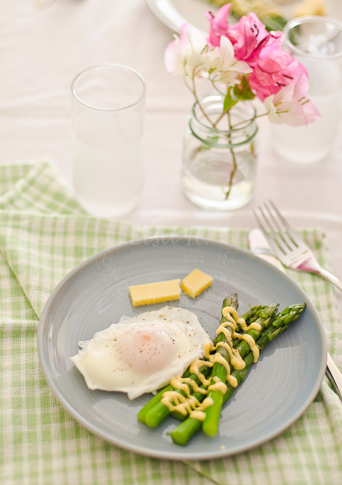 Asparagus drizzled with  Hollandaise Sauce.
