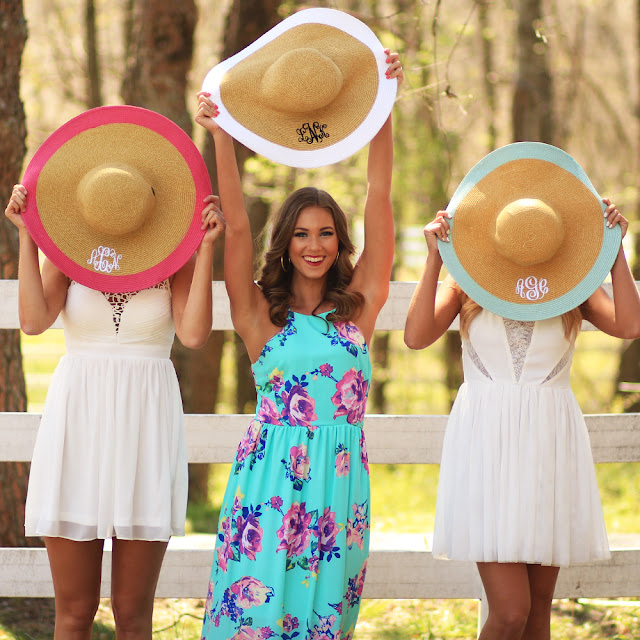 girls holding personalized sun hats