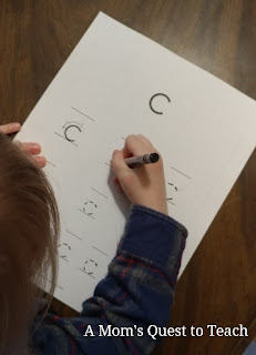 practicing writing letter c