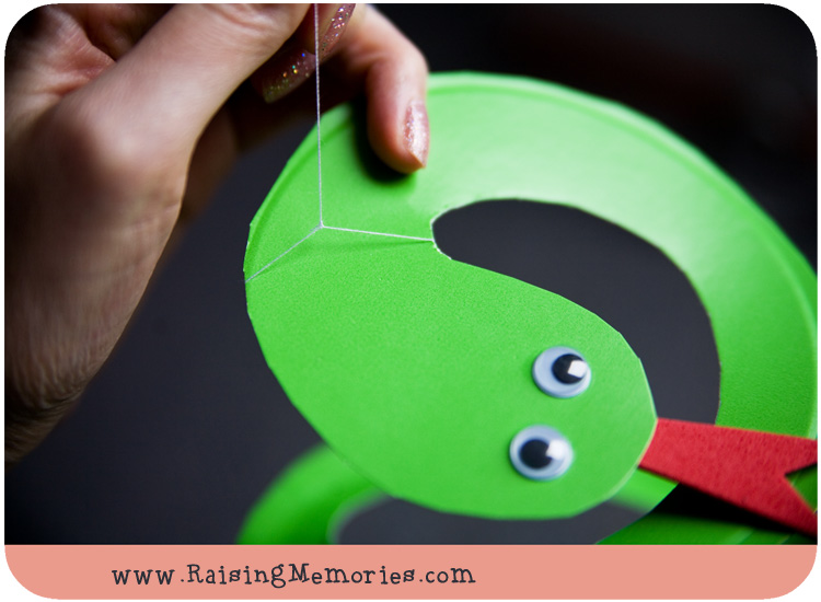 Add a string to make your Paper Plate Snake into a  Puppet