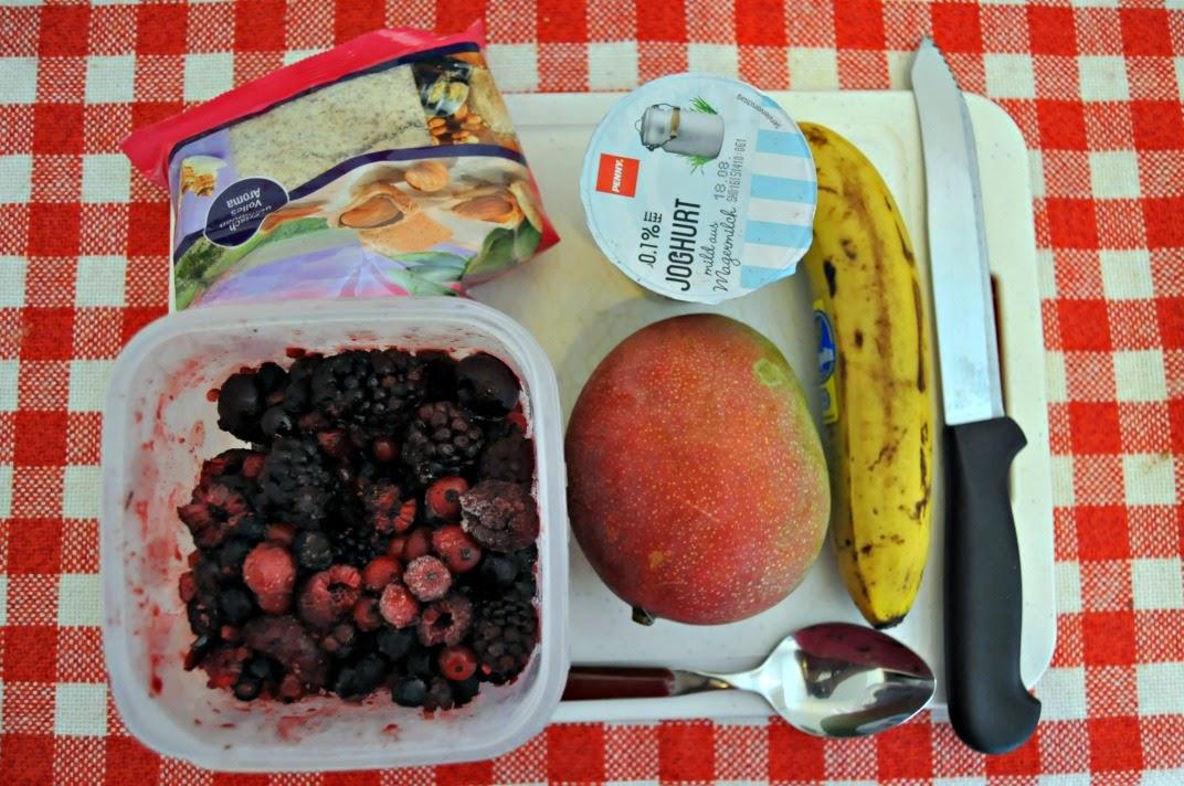 Banana, berries, mango and yoghurt breakfast smoothie