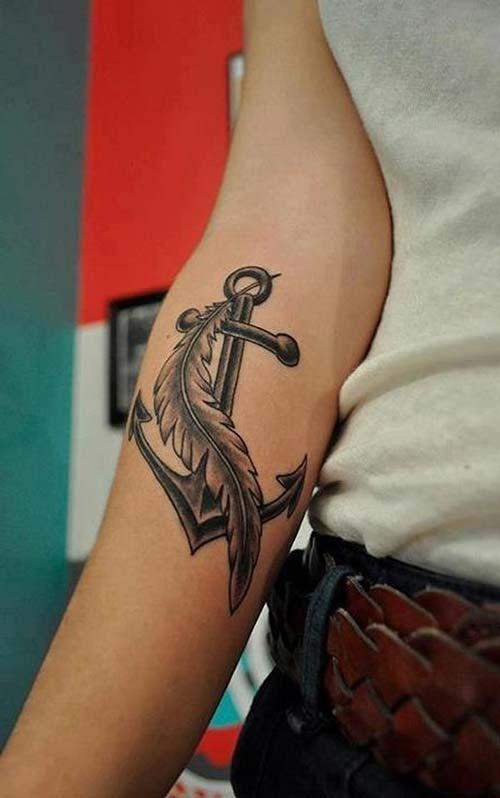 forearm anchor tattoo with feather alt kol tüy ile çapa dövmesi