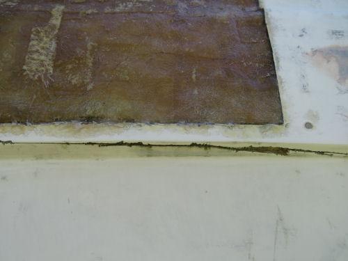 cut in wall of fiberglass trailer
