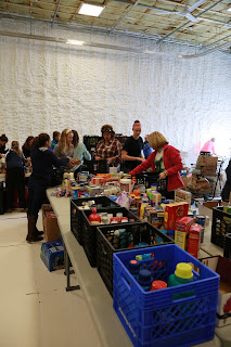 Campaign volunteers sort through donations collected in the drive. Photo courtesy of Bob Teixeira