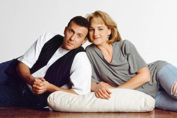 promotional image for Mad About You from the '90s showing Paul Reiser and Helen Hunt posing together