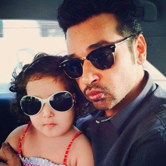 Faisal Qureshi with his daughter