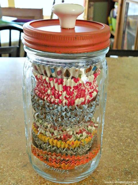 Cupcake liners stored in a jar organizing hack - One Mile Home Style