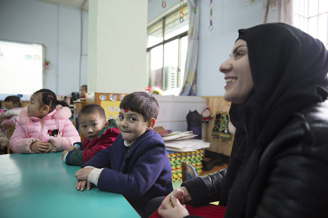 Manar Abdulhussein (L), 38, an Iraqi migrant, laughs in a kindergarten her son attends in Yiwu, China 11 January 2017. In 2016, Yiwu, Zhejiang Province, issued 9,675 people with temporary residence permits, nearly half of them from war-torn countries including Iraq, Yemen, Syria and Afghanistan. To match story CHINA-MIGRANTS/MIDEAST Thomson Reuters Foundation