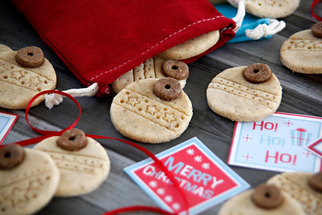 Homemade Christmas dog treats shaped like patterned tree ornaments