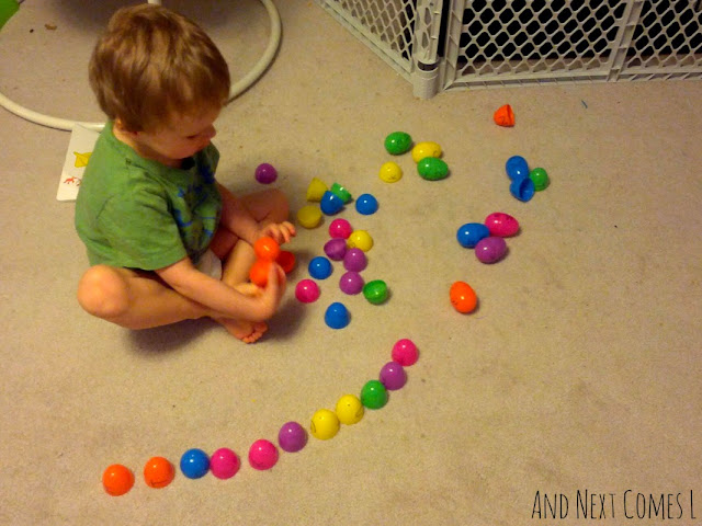 J playing with an alphabet matching easter egg busy bag from And Next Comes L