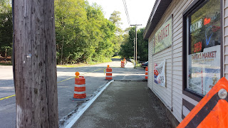 work on new sidewalks along Uncas Ave