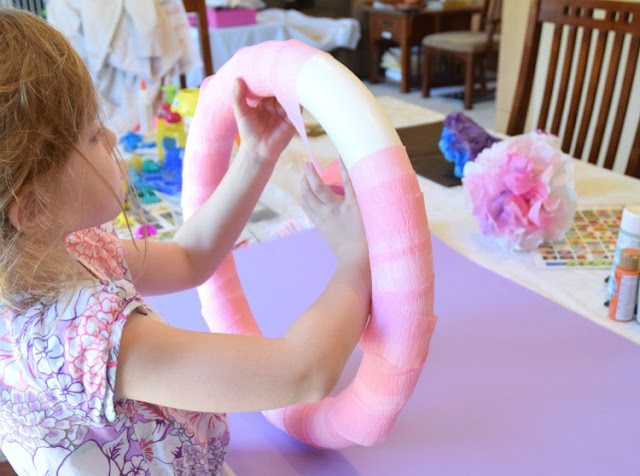 Tissue Paper Flower Wreath.  Beautiful decoration for spring or summer.  Kids can help make flowers and then attach them to the wreath with this easy and beautiful craft.