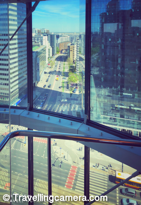 First of all, it's pretty big and in a high-rise building. The Westin, Warsaw is located in an area full of skyscrapers. And the lift in The Westin is designed in a such a way that surrounding roads and buildings are very well visible from it. Above photograph is clicked from the lift of The Westin Hotel in Warsaw.