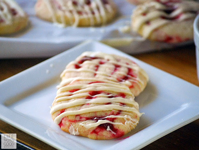 Cranberry Pinwheel Cookies | by Life Tastes Good are beautiful Christmas cookies made from my Vanilla Cookie Dough Recipe. The cranberry filled cookies drizzled with rich, creamy white chocolate are delicious and make a festive cookie for the holiday season.
