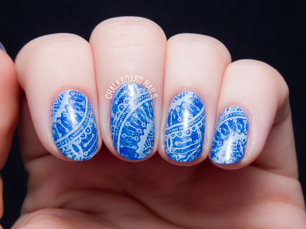 Blue stamping nail art by @chalkboardnails