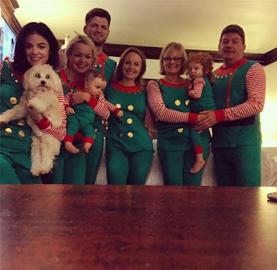 Lucy Hale wearing matching elf Christmas pajamas, favorite family holiday tradition