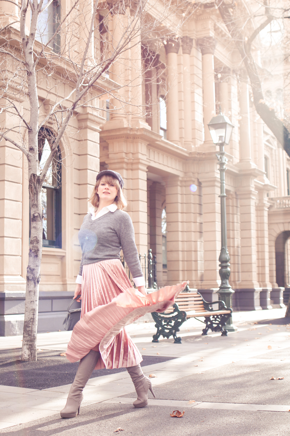 Liana of @findingfemme wears pink velvet pleated midi skirt in Bendigo, Victoria.