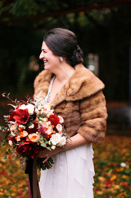 les fleurs : megan braemore photography : at home elopement : fall wedding : fur stole : burgundy, apricot, ivory & green bridal bouquet : garden roses, peony, ranunculus, amaryllis, foliage, berries