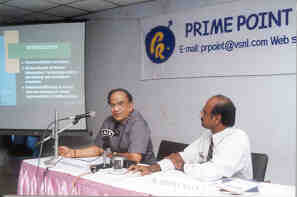 Mr T S Krishnamurthy, Election Commissioner of India making his presention.  Mr K Srinivasan, Founder of the Prime Point Foundation looking on