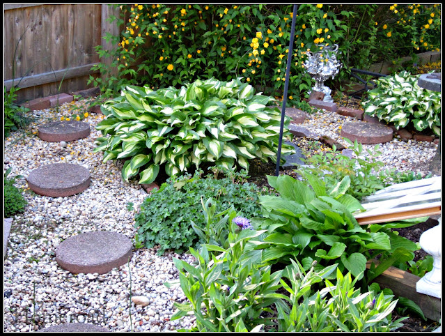 Perennial garden with pea gravel and stepping stones