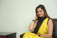 Cute Actress Ashwini in Yellow Saree Exclusive  042.JPG