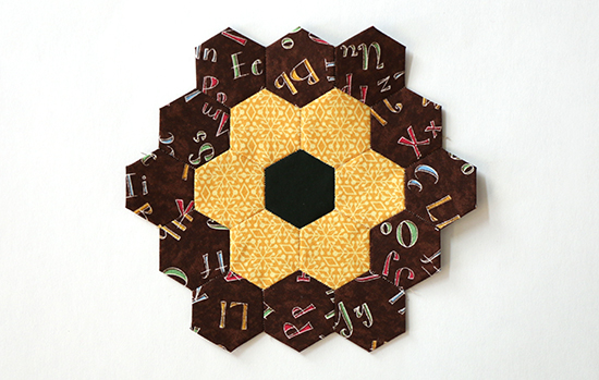 EPP Hexagon Flower Block 15 with Yellow Pattern and Colorful Letters on Brown