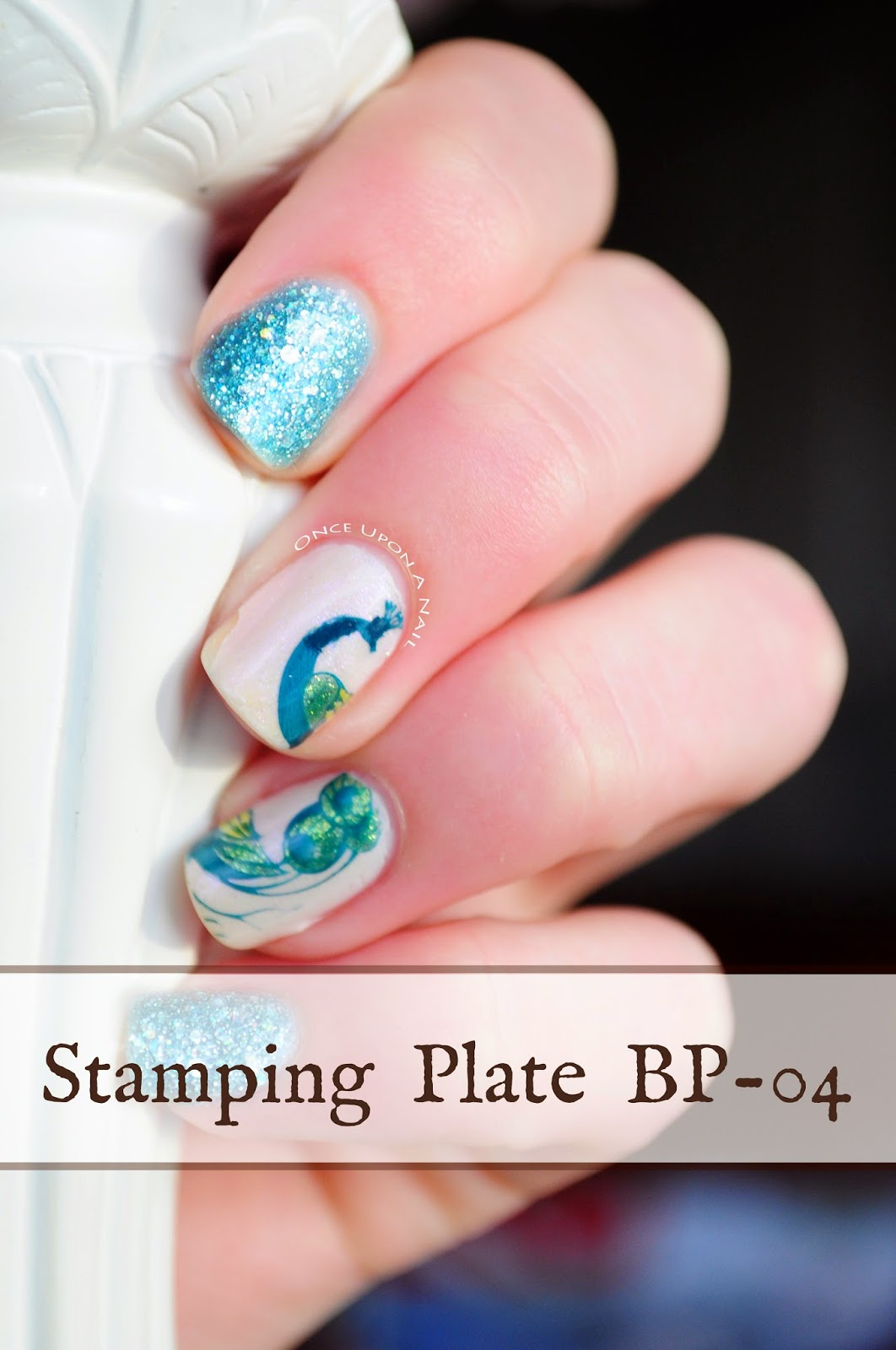 http://onceuponnails.blogspot.com/2015/01/peacock-stamp-review.html