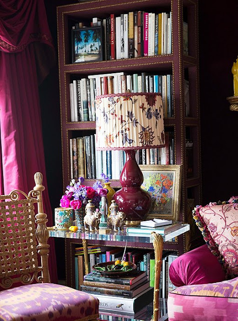 The shelves of the library with books on art, fashion and interiors | Alex Papachristidis's Manhattan apartment