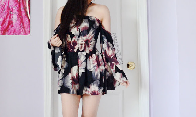 Off-shoulder flowy floral bell sleeve black romper playsuit from SheIn, with elastic bodice and burgundy floral print for boho vacation vibes.