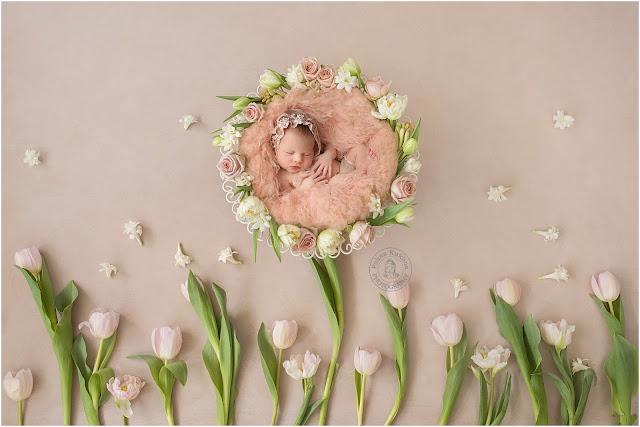 Newborn baby girl in a tulip wreath.
