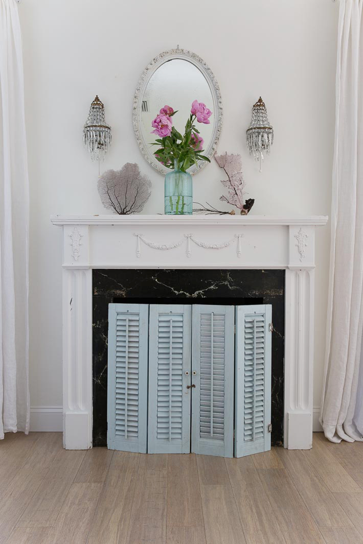 repurpose old shutters - fireplace cover - shabbyfufublog.com