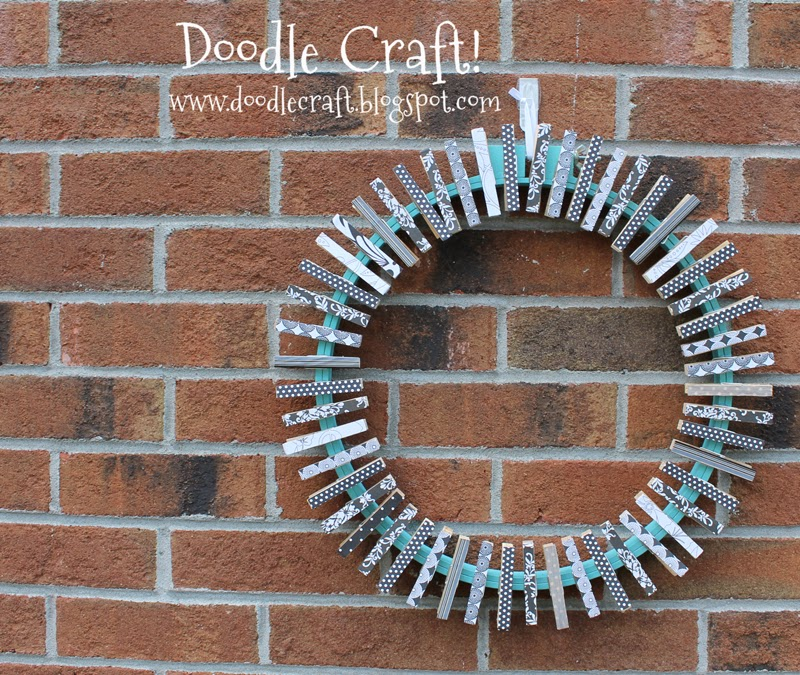 http://www.doodlecraft.blogspot.com/2012/06/upcycled-embroidery-hoop-and-clothespin.html