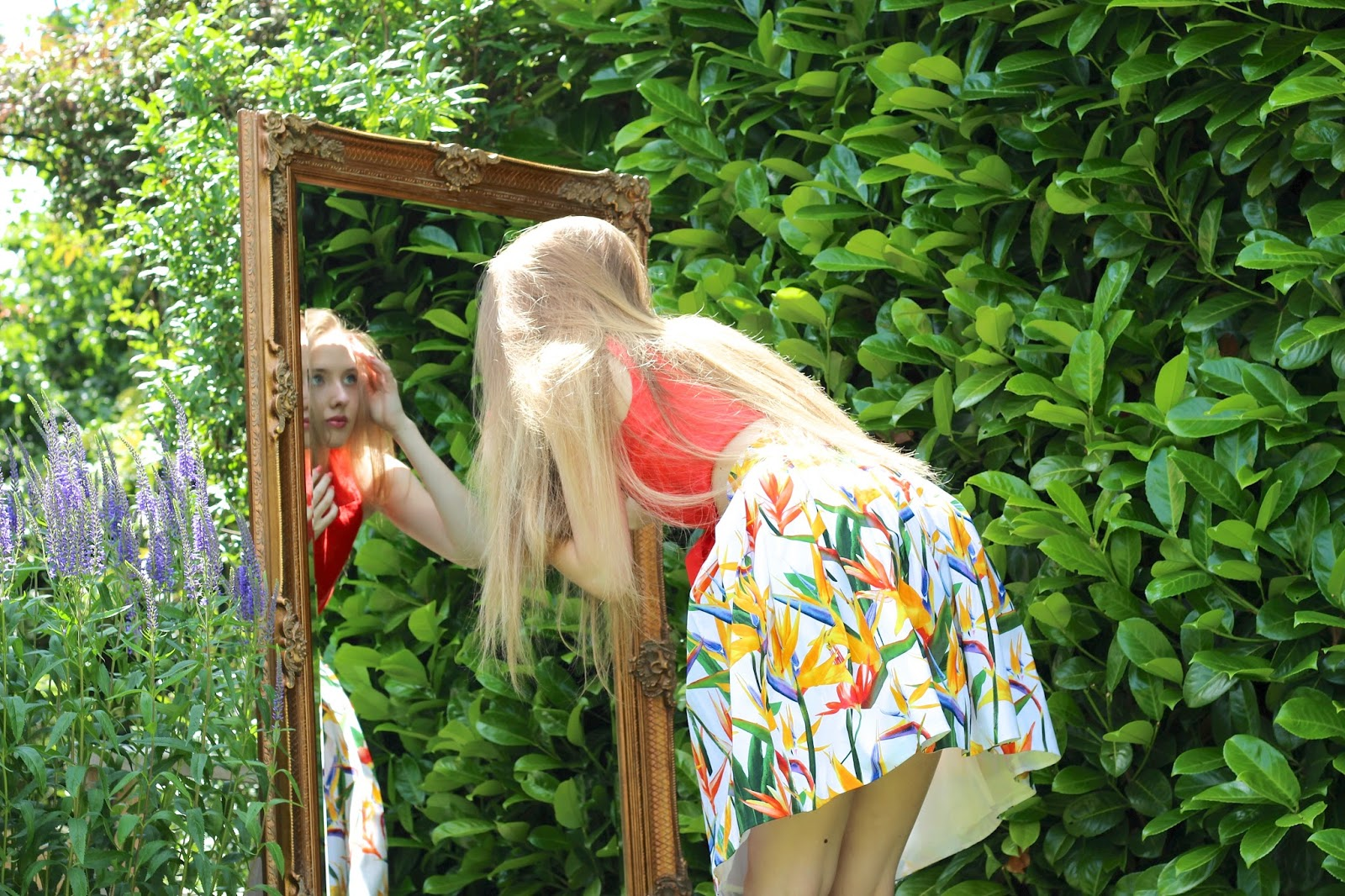 English fashion blogger alice in wonderland garden scene
