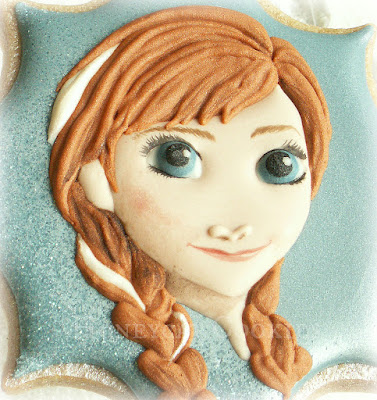 Finished handpainted decorated cookie of Anna from Disney's Frozen, by Honeycat Cookies