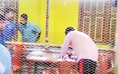 Saheb Ghosh, Trinamul supporter, stamps ballots at the counting centre