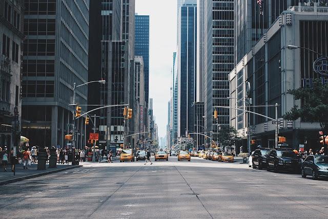 Cars waiting pedestrians cross the street
