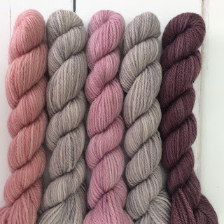 Five mini-skeins in greys and pinks
