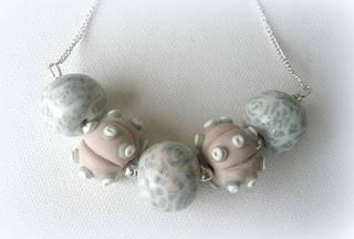 Polymer clay silver necklace fearing my new seashell cane and urchin beads