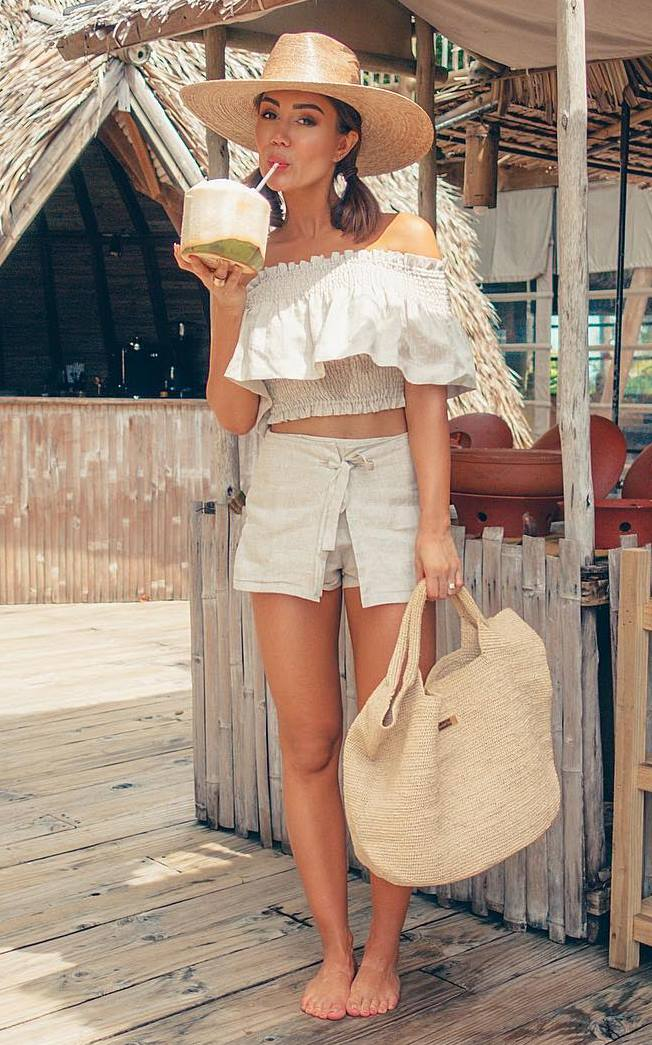 vacation outfit idea / ruffle top + straw bag + high waist shorts