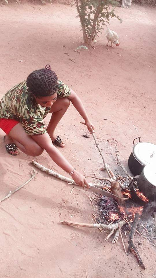 Photos: Slay queen catches bush rat in her village, kills, roast it and made pepper soup with it