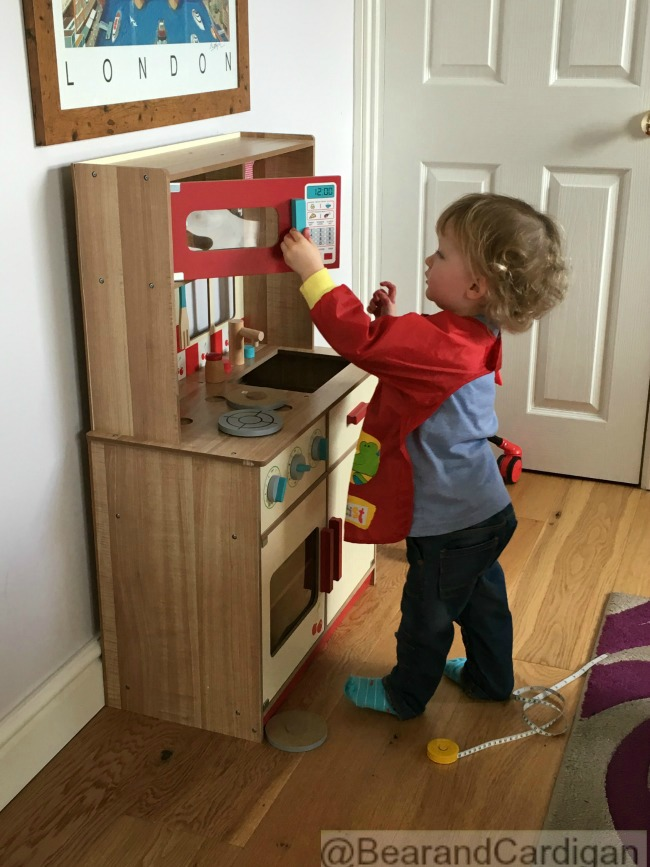 toddler opening play kitchen microwave door
