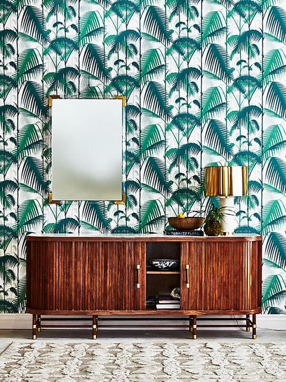 green palm leaves tropical wallpaper and retro furniture