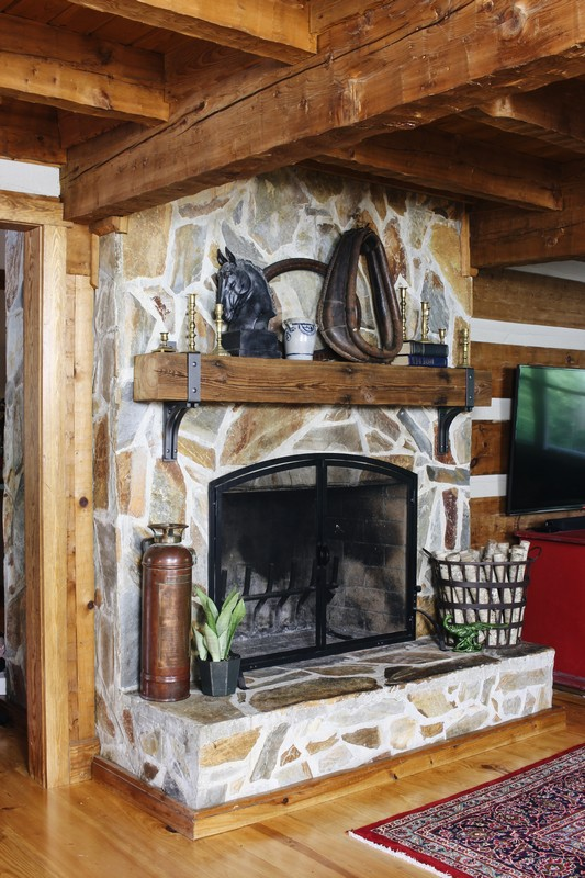 log-cabin-stone-fireplace-rustic-reclaimed-beam-mantel-styling