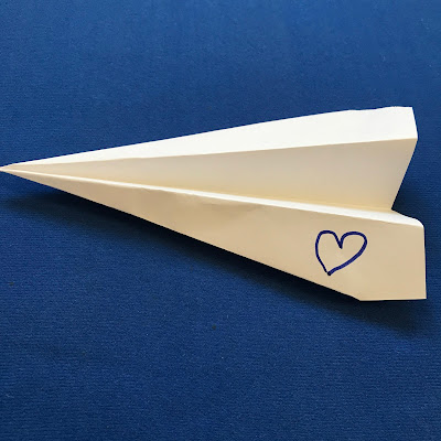 Letting Go: Interactive Paper Plane Prayers