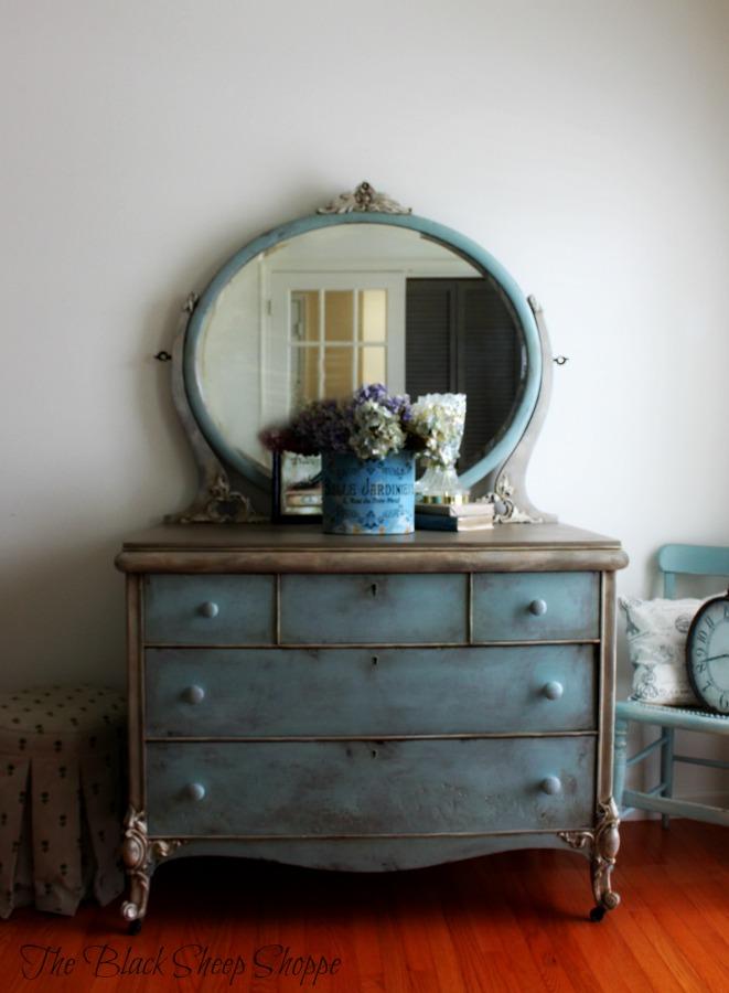 Vintage dresser with a faded grandeur finish.