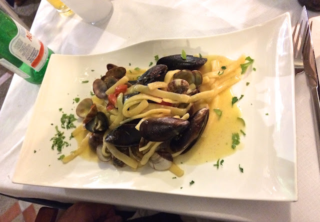 pasta with mussels on on rectangular platter