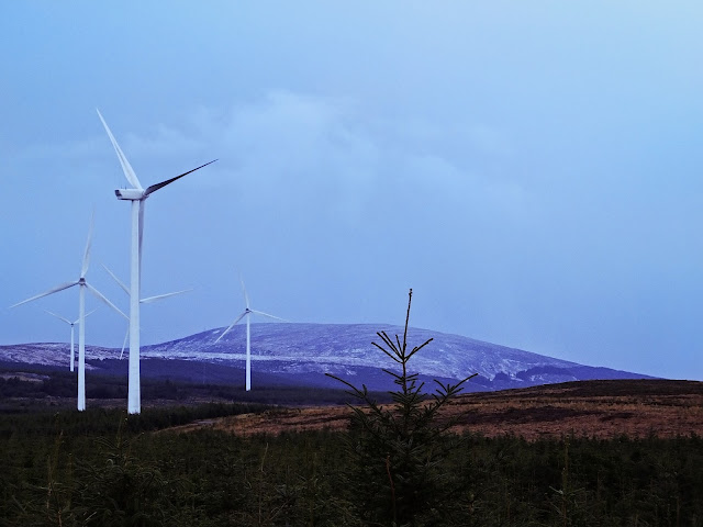 Windmill and snow covered mountain landscape in Co.Cork.