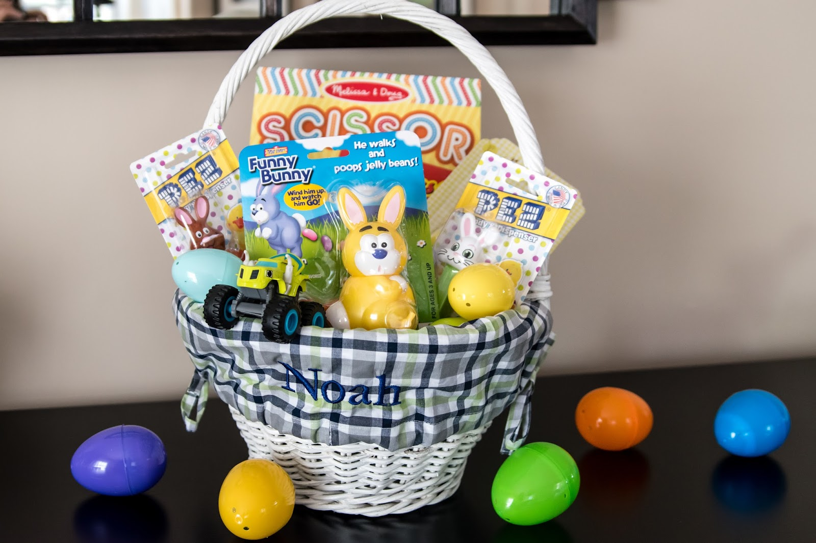 The adventure starts here noahs easter basket easter basket link up while it may seem like a lot most of the gifts are borderline educational that wed get him anyway this way its just in a pretty basket negle Choice Image