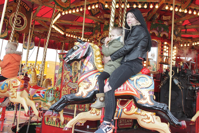 My niece and her mum on the Carters Steam Fair Gallopers ride horses.