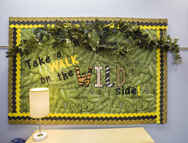 Animal print, safari, jungle themed bulletin board.  Love the bulletin board paper and layered borders!